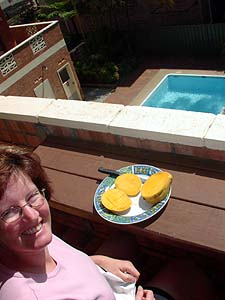 Megan eating mangoes on the balcony